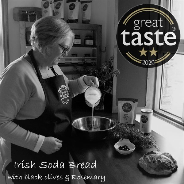 Black and white photo of Sian (Owner) pouring buttermilk into a bowl to make soda bread