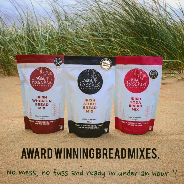 Wild Fuschia Bakehouse bread mixes sitting on the beach with wind swept grass behind them